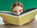 Surprised teenage girl with book. Royalty Free Stock Photo