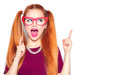 Surprised teenage girl holding funny paper glasses on stick Royalty Free Stock Photo