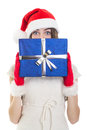 Surprised teenage girl wearing santa beanie holding big giftbox cute caucasian hat blue gift box isolated on white background Royalty Free Stock Images