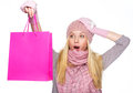 Surprised teenager girl in winter hat with shopping bag and scarf Royalty Free Stock Images
