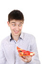Surprised teenager with pizza isolated on the white background Royalty Free Stock Image