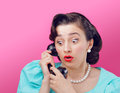 Surprised vintage woman talking on the phone Stock Photo