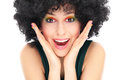 Surprised woman with afro wig Royalty Free Stock Image