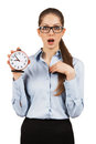 Surprised woman with an alarm clock in hands young Stock Photography