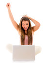 Surprised woman with arms up and looking at her laptop Stock Photos