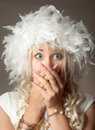Surprised woman with big blue eyes and a plume hat portrait of Stock Images