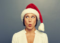 Surprised woman in christmas hat young red over grey background Stock Images