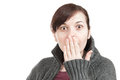 Surprised woman covering her mouth with hand Stock Photo