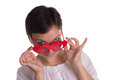 Surprised woman with funny glasses heart-shaped