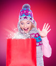 Surprised woman with gifts after shopping to the new year photo of happy at shop Stock Image