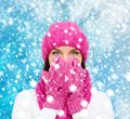 Surprised woman in hat muffler and mittens christmas x mas winter happiness concept Stock Photo