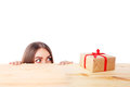 Surprised woman looks at a gift box. Christmas, x-mas, winter, happiness concept. Royalty Free Stock Photo