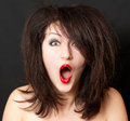 Surprised woman photo with tousled hair on a black background Stock Photo