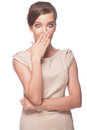 Surprised woman portrait of young beautiful covering her mouth by hand isolated on white background Stock Photo