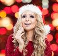 Surprised woman in santa hat portrait. Happy girl Royalty Free Stock Photo