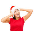 Surprised woman in santa helper hat christmas x mas winter happiness concept Stock Images