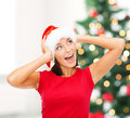 Surprised woman in santa helper hat christmas x mas winter happiness concept Royalty Free Stock Images