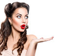 Surprised woman showing empty copy space Royalty Free Stock Photo