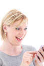 Surprised woman texting on her mobile Royalty Free Stock Photo