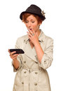 Surprised Woman Using Smart Phone on White Royalty Free Stock Image