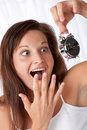Surprised woman watching alarm clock Royalty Free Stock Photography