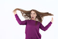 Surprised woman, woman in shock, surprise and flying hair. Blowing hair. Beautiful young girl posing in studio, emotions. Royalty Free Stock Photo
