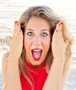 Surprised woman young blond with face Royalty Free Stock Photo