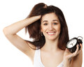 Surprised young brunette woman holding clock Royalty Free Stock Photo