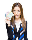 Surprised Young Business Woman Holding Money Fan Stock Photography
