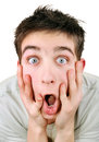 Surprised young man extremely on the white background closeup Stock Photography