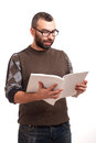 Surprised young man reading magazine Stock Photography