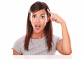 Surprised young woman pointing to her head Royalty Free Stock Photo