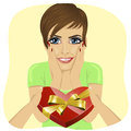 Surprised young woman receiving heart shaped box on the day of Valentine's Day from men's hand