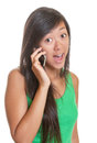 Surprising news for an asian girl young is happy about the suprising on the phone Stock Photos
