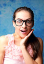 Surprising woman in glasses with opened mouth and hand at face Royalty Free Stock Images