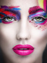 Surreal beauty close up shot of young woman multicolor make up on eyes Royalty Free Stock Photos