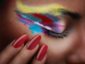 Surreal beauty closeup of young woman s eye with vibrant makeup Royalty Free Stock Photos