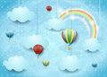 Surreal cloudscape with hot air balloons and rainbow