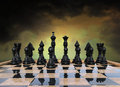 Surreal ominous chess game strategy and chessboard with a cloudy sky background Stock Photography