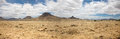Surreal panorama of the kaokoland game reserve in namibia sand track going toward skeleton coast desert with a blue sky Royalty Free Stock Photos