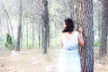 Surreal photo of young woman standing in forest. natural light. dreamy concept. Royalty Free Stock Photo