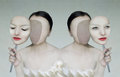 Surreal portrait of two woman faceless with her face masks Stock Photography