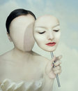 Surreal portrait of a woman faceless with her face mask Royalty Free Stock Image