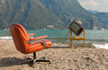 Surreal scene vintage decor on the lake shore armchair and television Royalty Free Stock Image