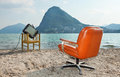 Surreal scene vintage decor on the lake shore armchair and television Stock Photos