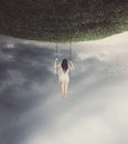 Surreal swing with woman