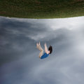 Surreal woman falling image of a up towards the sky Stock Images