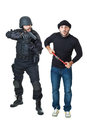 Surrender yourself a scared burglar busted by a swat or police officer Royalty Free Stock Photo