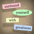 Surround yourself with greatness saying quote words motivation in a or pinned to a bulletin board for and inspiration Royalty Free Stock Photography