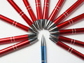 The surrounding red to blue pens in a circle on a Royalty Free Stock Photo